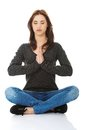 Pretty Student Girl Meditating In Lotus Pose. Royalty Free Stock Images - 45439919