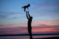 Silhouettes Of Father Tossing His Child Stock Photo - 45449570