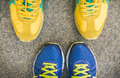 Two Pairs Of Bright Sport Shoes Standing In Front Of Each Other Royalty Free Stock Images - 45467229