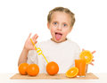 Little Girl With Oranges Drink Juice With A Straw Royalty Free Stock Image - 45477116