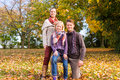 Family In Front Of Colorful Trees In Autumn Or Fall Stock Photos - 45479583