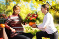 Beautiful Young Pregnant Couple Having Picnic In Autumn Park. Ha Royalty Free Stock Photo - 45497015