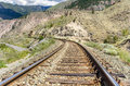 Curving Railway Track In A Mountain Landscape Royalty Free Stock Image - 45498796