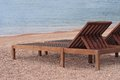 Wooden Sunbeds On The Beautiful Beach Near The Sea Royalty Free Stock Photo - 45518005