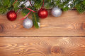 Christmas Fir Tree With Snow And Baubles On Rustic Wooden Board Stock Photo - 45528790