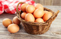Chicken Eggs In Basket On Grey Wooden Background. Stock Photography - 45532932