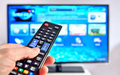 Smart Tv And Hand Pressing Remote Control Stock Photo - 45556560