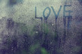 Inscription Love On The Wet Glass Rain Royalty Free Stock Images - 45557529