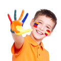 Happy Smiling Boy With A Painted Hand And Face. Royalty Free Stock Image - 45574946