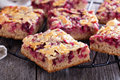 Berry Cake Bars With Caramel Almond Topping Stock Images - 45576944