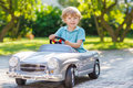 Little Boy Driving Big Toy Old Car, Outdoors Stock Images - 45640874
