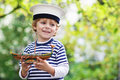 Happy Child In Skipper Uniform Playing With Toy Ship Royalty Free Stock Photos - 45642588