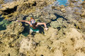 Man In The Mask Floats On A Coral Reef In The  Sea Stock Photos - 45651383
