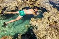 Man In The Mask Floats On A Coral Reef In The  Sea Stock Photos - 45651543
