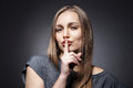 Young Woman Gesturing For Quiet Or Shushing Stock Photo - 45655470