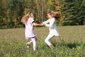 Kids - Girls Dancing On Meadow Stock Photography - 45664702