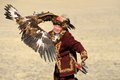Kosh-Agach,Russia - September 21, 2014: The Hunter With An Eagle Royalty Free Stock Photography - 45674947