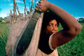 Fijian Woman Carries Sack Of Kava Stock Photography - 45685982