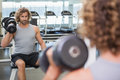 Young Man Exercising With Dumbbell In Gym Stock Photography - 45687932