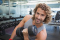 Young Man Exercising With Dumbbell In Gym Stock Photo - 45687970