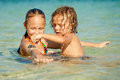 Happy Kids Playing On Beach Stock Images - 45692544