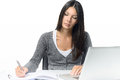 Serious Young Woman Working At A Desk Royalty Free Stock Photography - 45699437