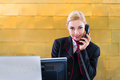Hotel Receptionist With Phone On Front Desk Royalty Free Stock Photo - 45706085