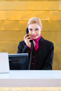 Hotel Receptionist With Phone On Front Desk Stock Images - 45706094