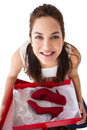 Happy Brunette Holding Present With Shoes Stock Photo - 45716560