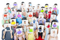Group Of People Holding Tablets In Front Of Faces Royalty Free Stock Image - 45718216