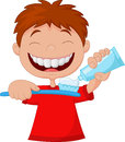 Kid Cartoon Squeezing Tooth Paste On A Toothbrush Stock Images - 45746094