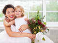 Smiling Happy Bride And A Flower Girl Indoors Royalty Free Stock Photo - 45754435