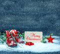Christmas Decoration Red Stars And Antique Baby Shoes In Snow Royalty Free Stock Photo - 45759175