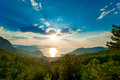 Pine Trees In The Mountains And The Rising Sun Stock Photos - 45760033