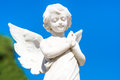 Beautiful Infant Angel On A Blue Sky Royalty Free Stock Image - 45761676