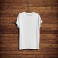 White T-shirt On Wood Wall Royalty Free Stock Photography - 45780277