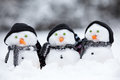 Three Little Snowmen With Hats Stock Images - 45796434
