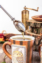 Tea Strainer On Wooden Table With Homemade Cookies And Grinder Royalty Free Stock Images - 45798529