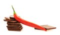 Red Chili Pepper Over Chocolate Pieces Stock Photo - 45812930
