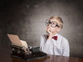 Boy With The Old Typewriter Royalty Free Stock Photo - 45820905