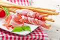 Grissini Bread Sticks With Ham, Tomato And Basil Stock Photos - 45824013