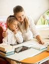 Mother Pointing In Exercise Book And Explaining Homework To Daug Royalty Free Stock Images - 45825489