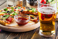 Pizza Hawaii With Beer Royalty Free Stock Photos - 45835668