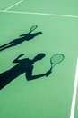 Players Shadows On The Tennis Court Royalty Free Stock Photo - 45862935