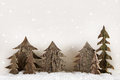 Handmade Carved Christmas Trees On Wooden White Background. Royalty Free Stock Photos - 45906658
