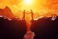 Two Men Shake Hands Over Precipice. Business Handshake Royalty Free Stock Images - 45908139