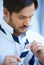Businessman Dressing Tying His Tie Royalty Free Stock Photography - 45928077