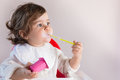 Baby Girl Eating Yogurt With Messy Face Stock Images - 45937084