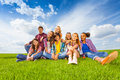 Happy International Children Sit On Green Meadow Royalty Free Stock Photography - 45952987