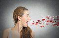 Woman Sending Kisses, Red Hearts Coming Out Of Open Mouth Royalty Free Stock Photos - 45998748